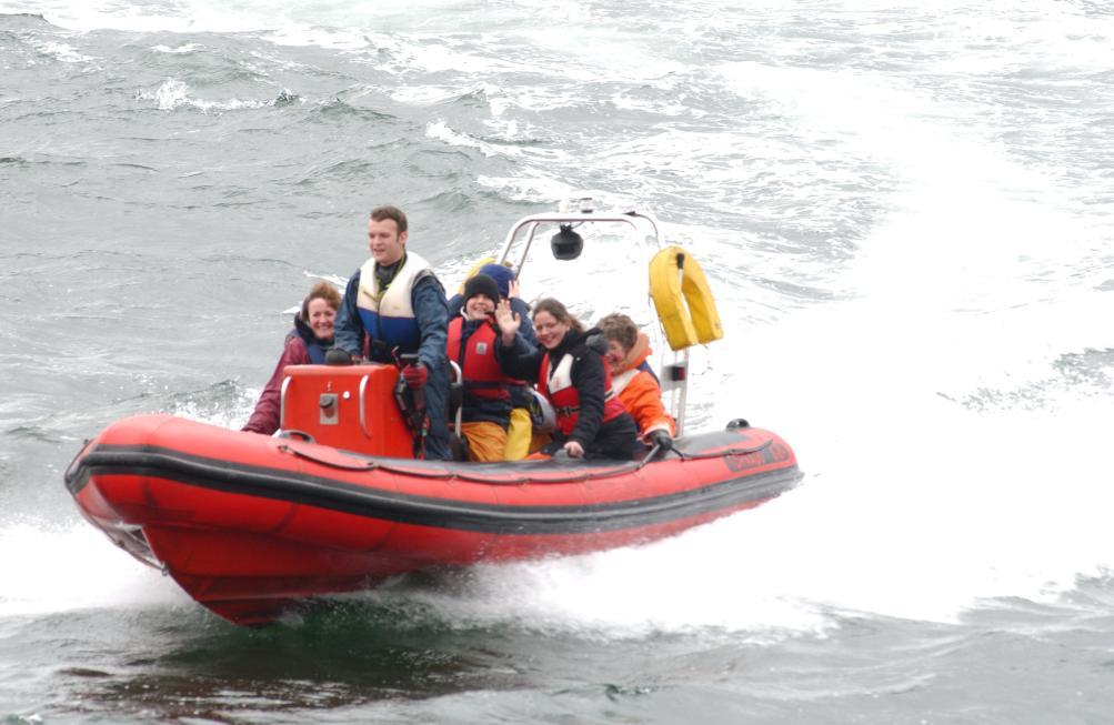 View of RIB with passengers enjoying a high-speed manoeuvre